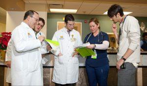 UM Hospital doctors and nurses talking.