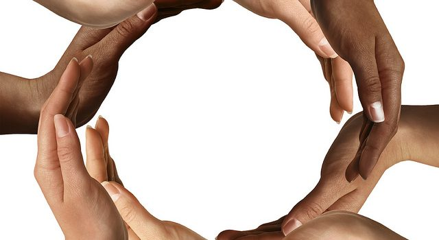 Multiple hands forming a circle